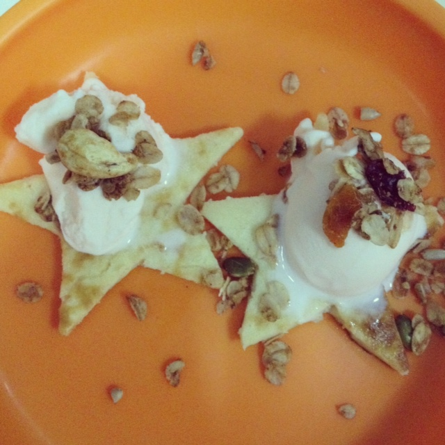 Star pancakes with yogurt ice cream and granola toppings