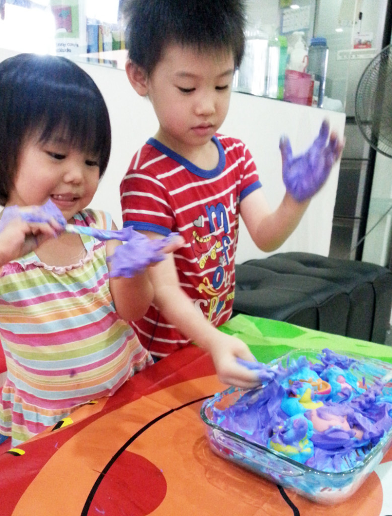 Having fun feeling cream on their hands