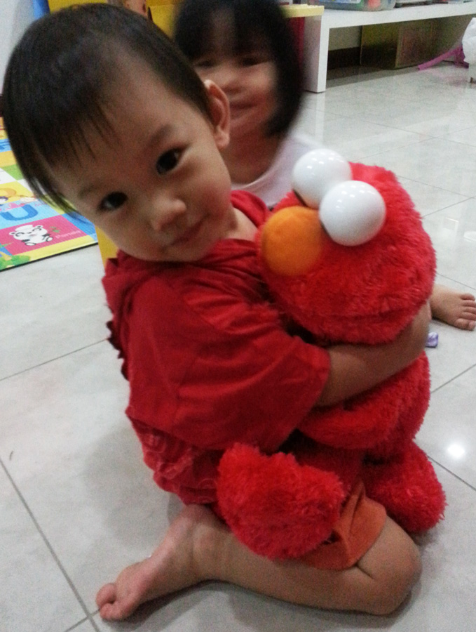 Hugging Elmo tighter