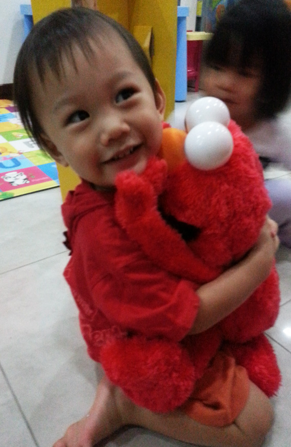 Hugging Elmo