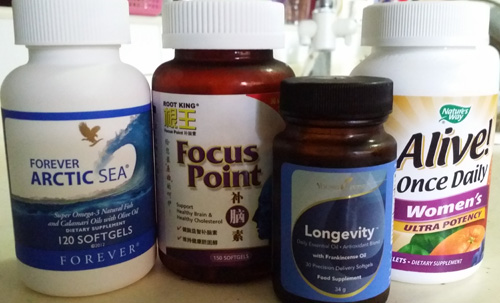 I used to never take any supplements but now I'm liking what I'm taking (from L to R): I'm getting sponsored to try out Forever Living's Arctic Sea; Focus Point (by Root King) from my MIL who insists that I take these for my brain and cholesterol; Longevity from YL which lets me swallow Frankincense, Clove & Orange in a capsule; and a Multivitamin from Nature's Way which the husband makes me take