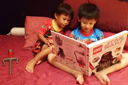 The boys sharing a moment together exploring a book, which happened all so suddenly. Moments before that they were swordfighting!