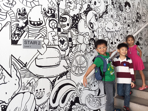 Imagine-a-doodle by Singapore collective Band of Doodlers: illustrations sprawled across the walls and winding their way up the four levels of SAM at 8Q