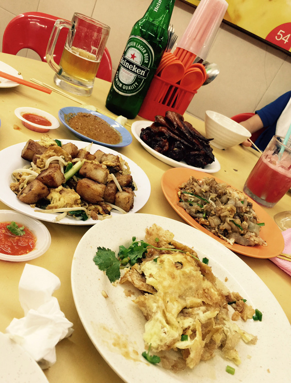 Our dinner consisting of chicken wings, satay, oyster omelette, carrot cake, char kway teow, beer (for the adults) and juice (for the young 'uns)