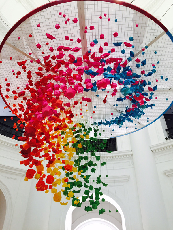Spectrum of Paper by Mademoiselle Maurice (France): Step into a rainbow wonderland at the Rotunda and immerse yourselves in a kaleidoscope of colourful, suspended origami boats and planes!