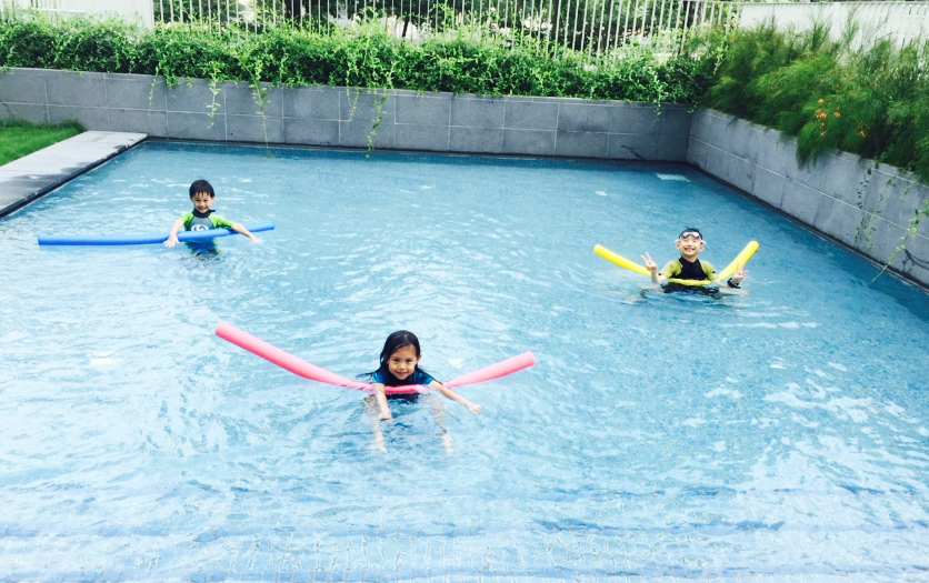 Pool-noodling in the wading pool