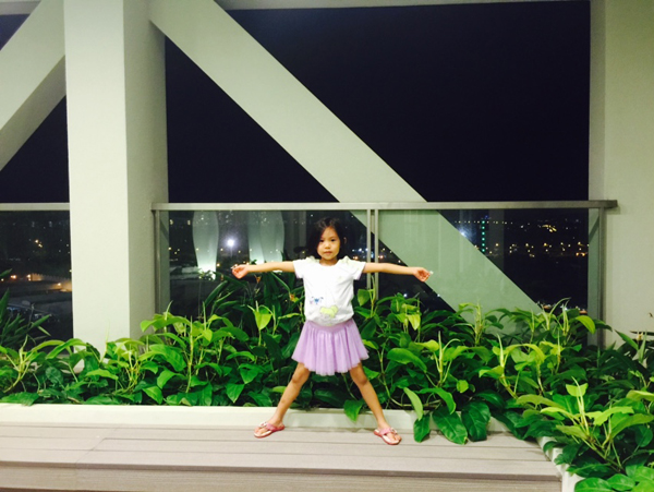 Someone stands on the Sky Bridge on the 26th level and says she's on top of the world!