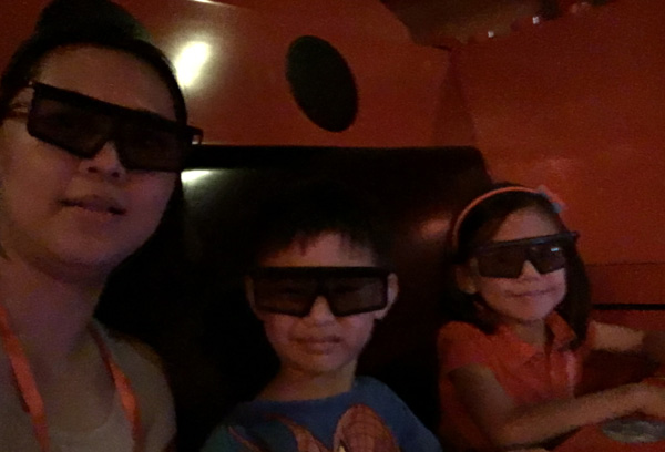 The two littles insisted they were afraid and needed to be with me. They gamely put on those 3D glasses nonetheless...
