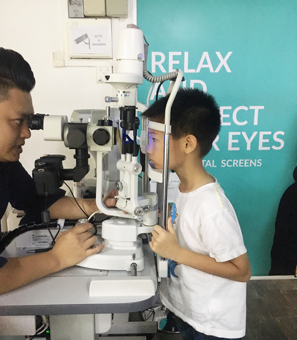 Checking the health of his cornea
