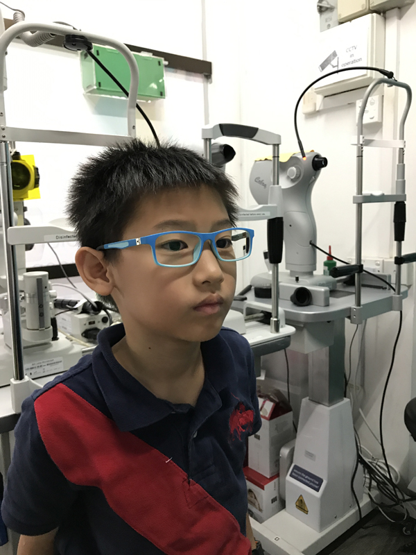After taking them off, and trying on his full degree spectacles for fit and comfort. This pair of spectacles is to stand by for days he wouldn't be able to put on his Ortho-k, like if he falls ill or goes for camps